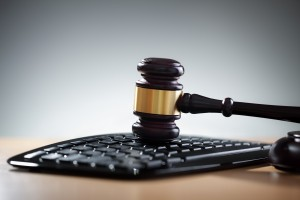 Justice gavel and computer keyboard