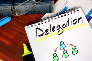 Delegation written on a notepad